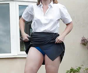 I was given this uniform of short grey skirt and blouse by a fan, and I just added the knee length white socks. As you c