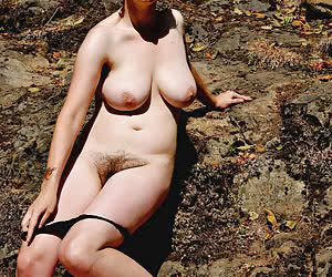 Young fat women a bit shy to pose nude outdoors