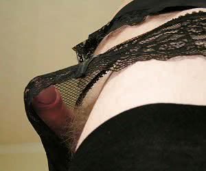 A crossdresser posing in heels and stockings collection