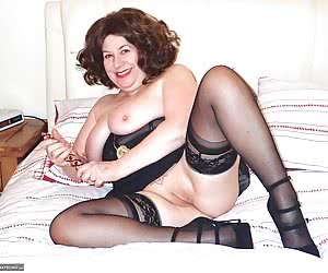 Heres a Hot Pic Set of Auntie Trisha playing on the bed and she doesnt waste any time in getting down and dirty spreadin