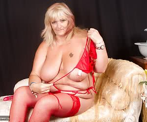 Hi Guys Heres a Red Hot Photoset I shot with Mazza a  Hot  Horny MILF From up North, she was Dressed all in Red with Red