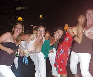 Big groups of girls flashing with their tits together