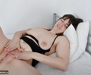 In lingerie and heels on the bed.Oh yes, I take off me Yes like also in front of the camera.Without panties but much nic