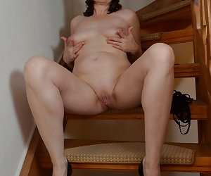 In the holiday apartment on an old wooden stair.Posing in nice underwear with blindfold.In the seat Stripping I and show