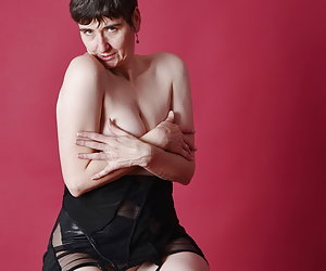 Posing in the Studio in Wetlook Dress and Over-knee thigh bootsYes, I do not wear underwear as usual, nor do I.So nude p