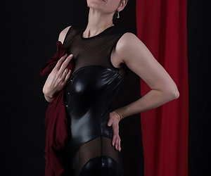 Under the normal dress I wear a wetlook suit.A desired combination.I like to wear something so unusual.