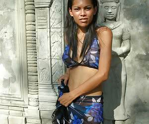 Perfect thai shemale showing huge boobs and hot ass