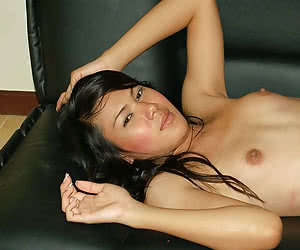 Sweet and shy asian shemale taking off her panties