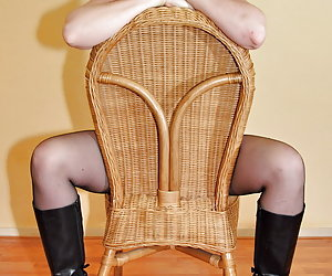 Jessica is posing nude wearing only boots and nylon stockings.