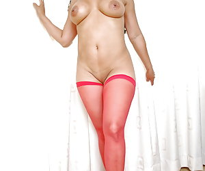 Mature Latina stripper Serena takes of her skirt and is then only wearing her red nylon stockings.Serena has an awesome