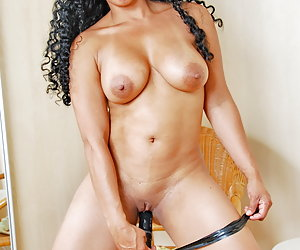 Serena is a sexy mature Latina stripper dressed only in her underwear.Now Serena is stripping nude and starts masturbati