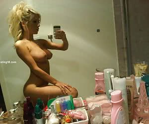 A stunning blonde amateur Girls next door with perfect face posing nude at home