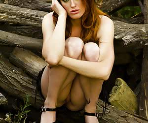 Gorgeous redheaded model proudly exposing every inch of her sexy body
