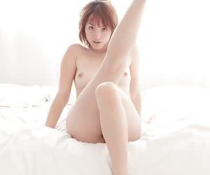 Sweet barely legal redhead exposing all her goodies on the wide bed