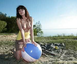 Extremely sweet young babe enjoying her vacation in the nude on the wild beach