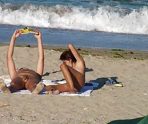 Ordinary amateurs taking their clothes off and having fun on a beach