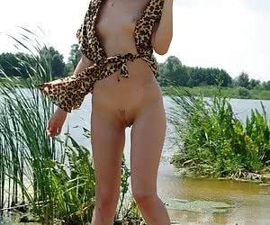Small breasted young sweetie having nude fun in the warm water
