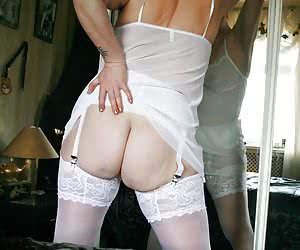 My photographer took some amazing reflection shots, of me in lovely white lingerie and stockings.