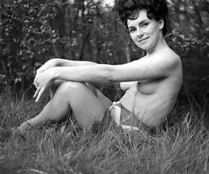 Pretty temptress in vintage lingerie becomes short of breath while posing and showing her body outdoors