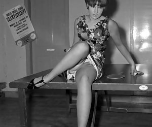 Retro lingerie pictures featuring gorgeous gals raise their legs to show their sweet legs in stockings