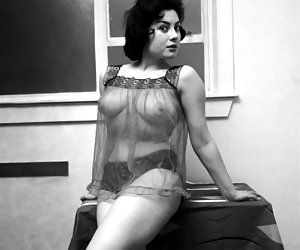 This time busty brunette girl poses in black vintage lingerie and looks more than just hot and attractive