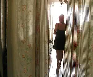 Home voyeur cam takes the intimate photos of cutie while she takes her dress off