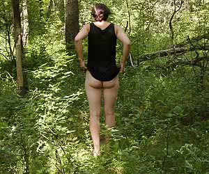 Real voyeur pics of unsuspecting chick caught in bushes while she pisses and shines by her ass