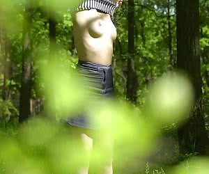 Some true voyeur shots of undressing cutie that gets ready to take sun-bath in the trees