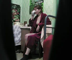 Spying on unaware gal drinking and flashing by her goodies in the wild-open robe
